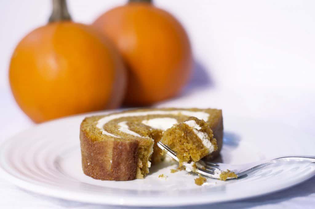 Pumpkin Roll | kickassbaker.com #pumpkinroll #pumpkinrecipes #pumpkin #fallrecipes #fall #autumn #easyrecipes #kickassbaker #creamcheese
