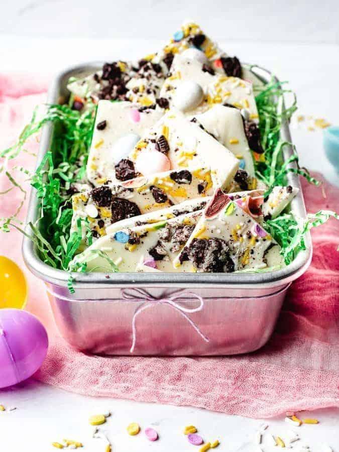 White Chocolate Oreo Easter Bark   kickassbaker.com #easter #dessert #easyrecipe #easyrecipes #nobake #oreo #whitechocolate #cadburyeggs #cadbury #bark #kickassbaker #holiday #treats #kidfriendly #nonuts #peanutfree #nutfree