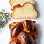 Challah Bread overhead shot with slices in front and flowers off the side | kickassbaker.com