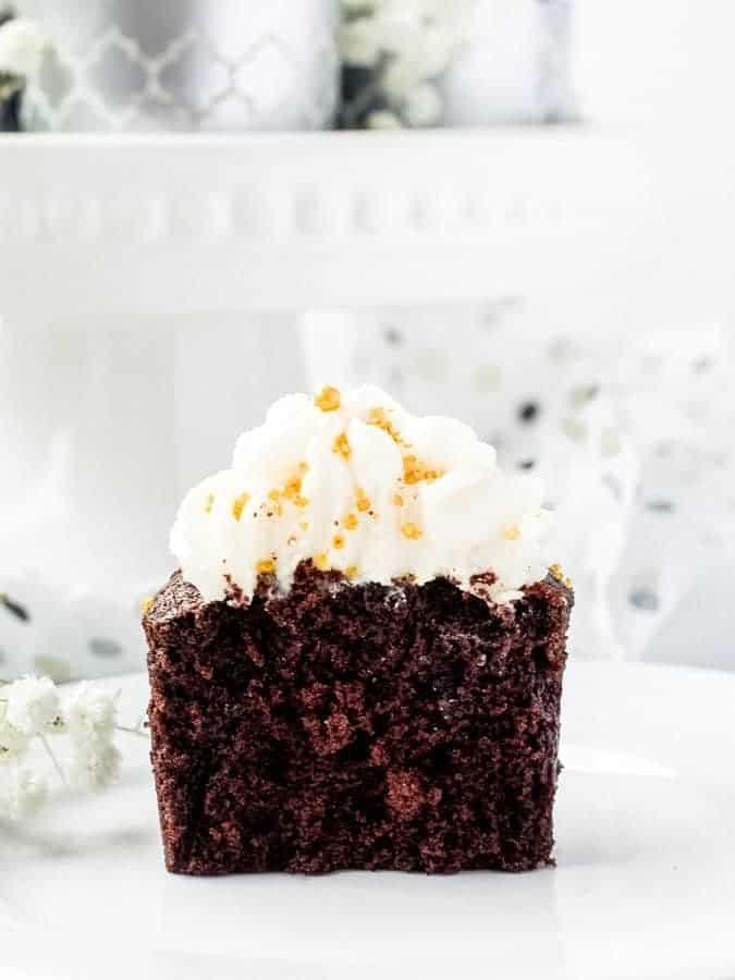 Chocolate Sour Cream Fudge Cupcakes single cupcake cut in half straight on | kickassbaker.com