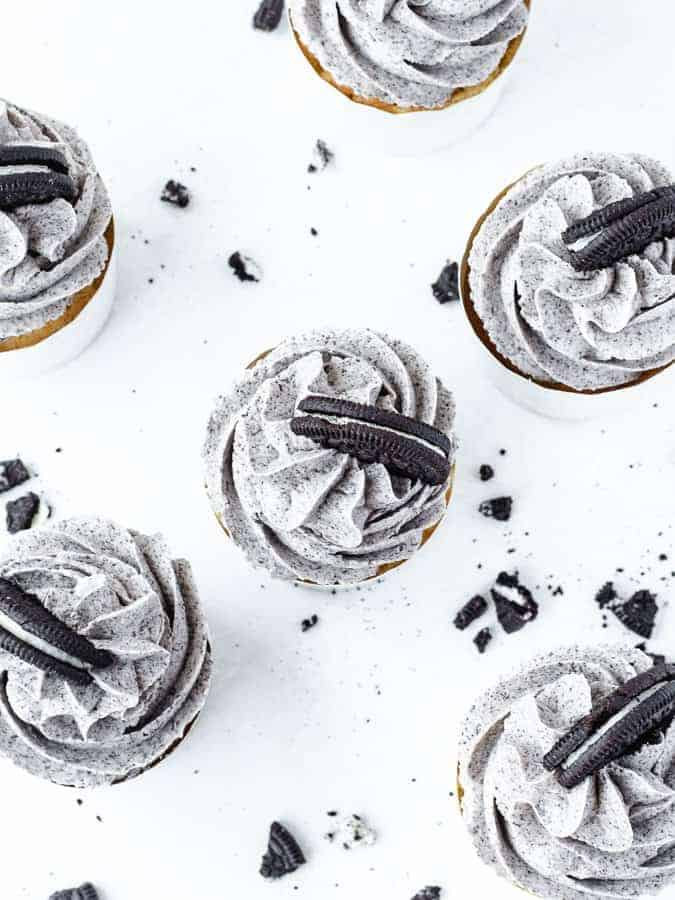 Overhead shot of Oreo cupcakes with Oreo cookies scattered around