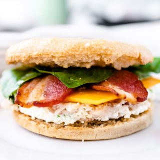 Close up of make ahead egg white gluten free breakfast sandwich with bacon and spinach