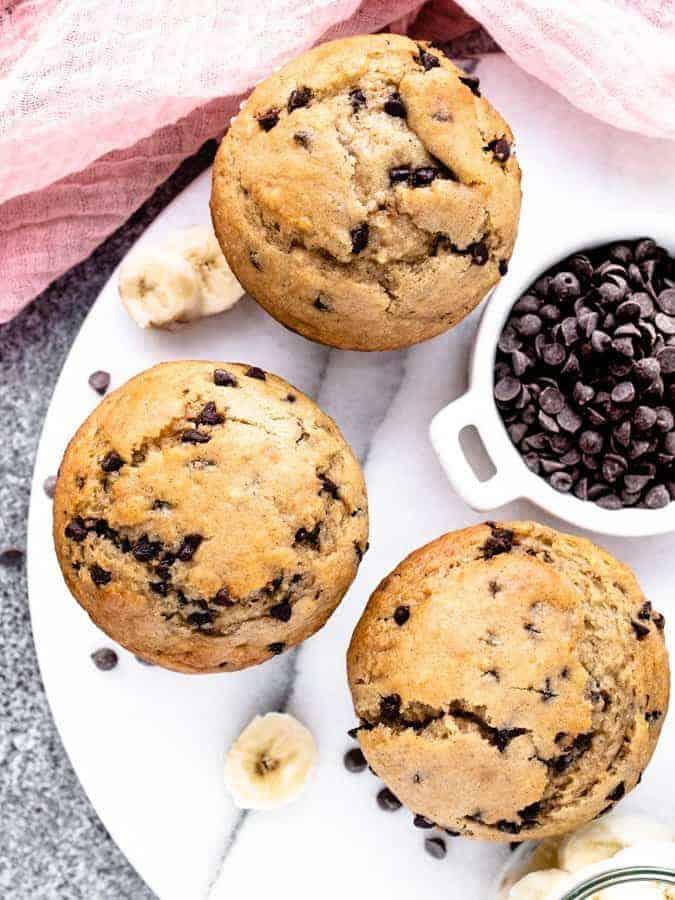 Overhead photo of 3 banana chocolate chip muffins