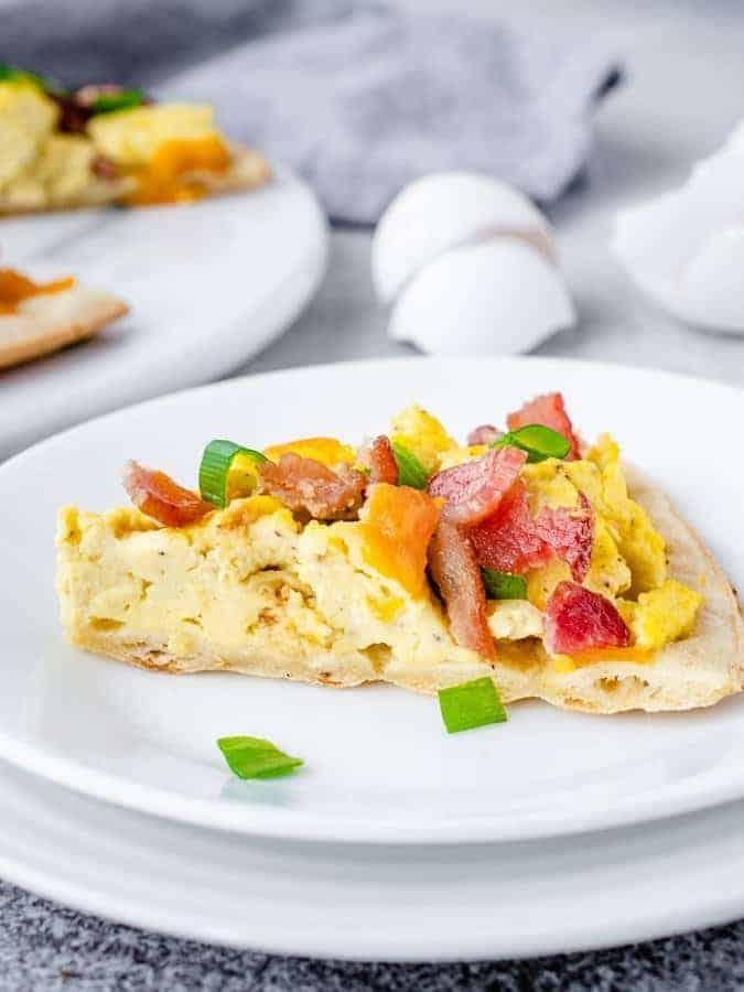 Slice of cauliflower crust breakfast pizza on a plate