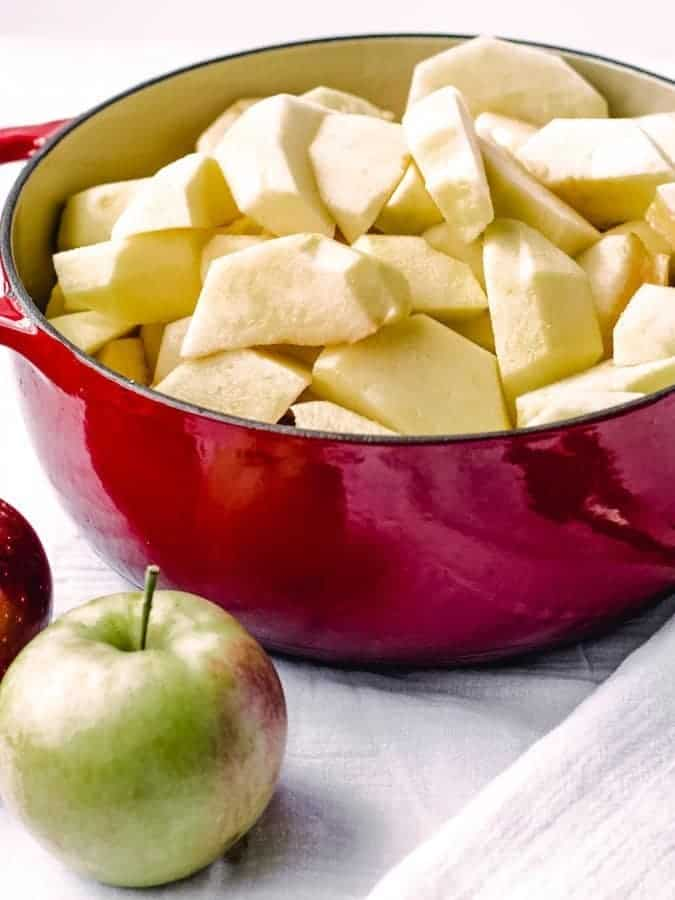 Apples cored and quartered ready to be cooked into homemade applesauce