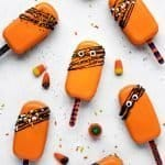 Overhead image of halloween cake pops with candy corn scattered around