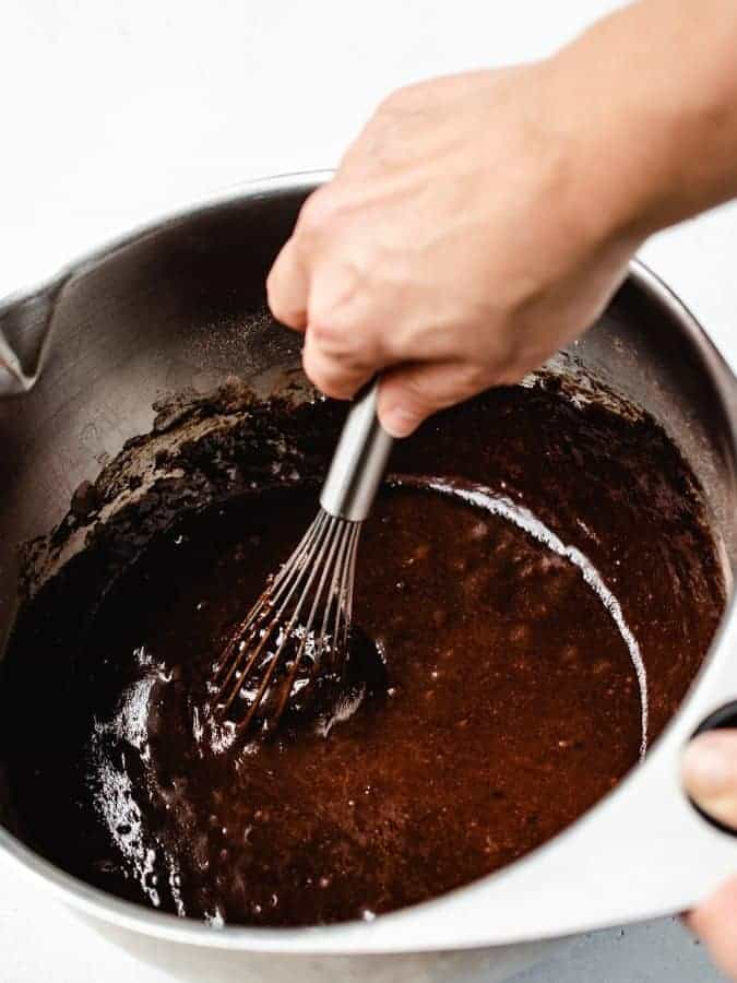 Whisking chocolate Swiss roll cake batter