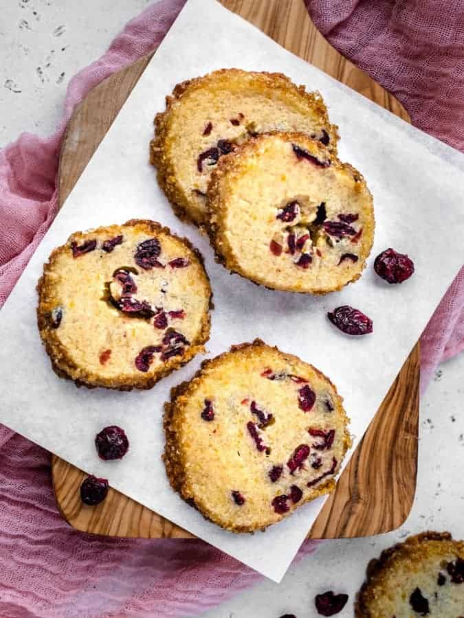 Overhead photo os shortbread cookies with cranberries around