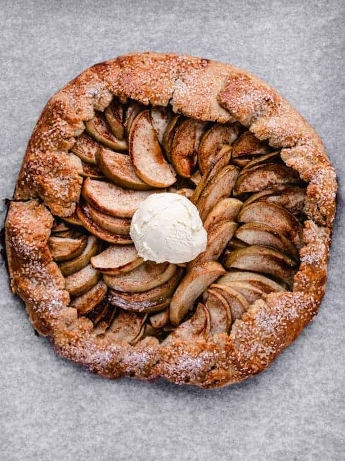 freshly baked maple apple galette with scoop of vanilla ice cream in the middle