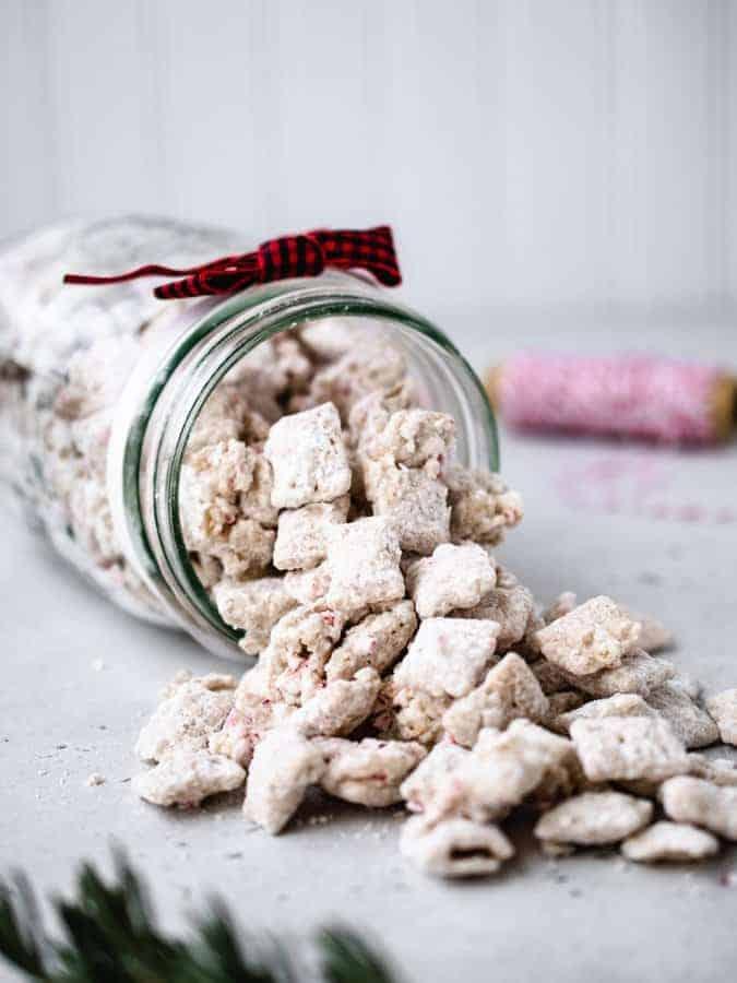 Peppermint Puppy Chow spilled from a mason jar