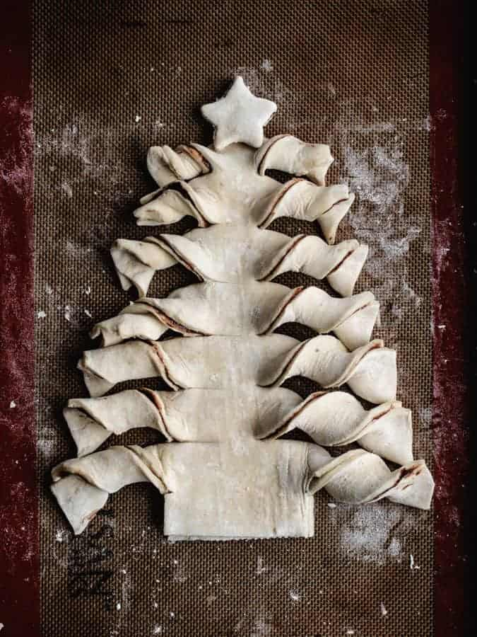 Puff Pastry Christmas tree with star on top ready to be baked