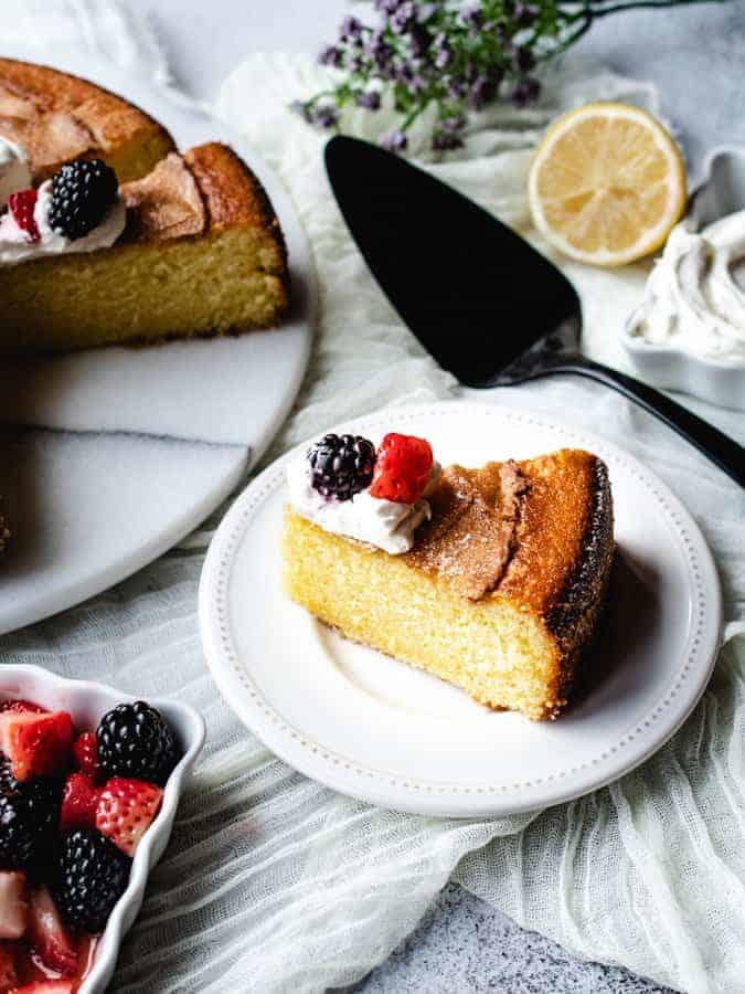 lemon olive oil cake sliced on a plate