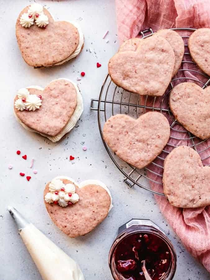 Assembling strawberries and cream cookie sandwiches