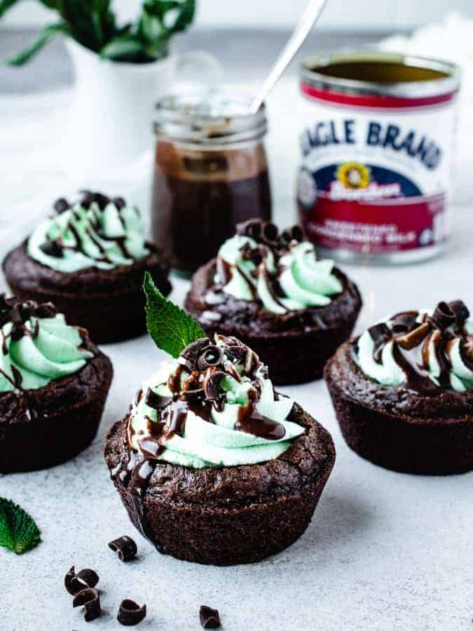 chocolate mint brownie cups with chocolate ganache drizzled on top