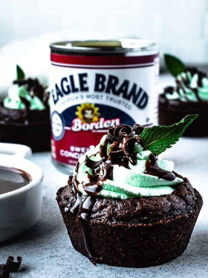 chocolate mint brownie cup in front of a can of sweetened condensed milk