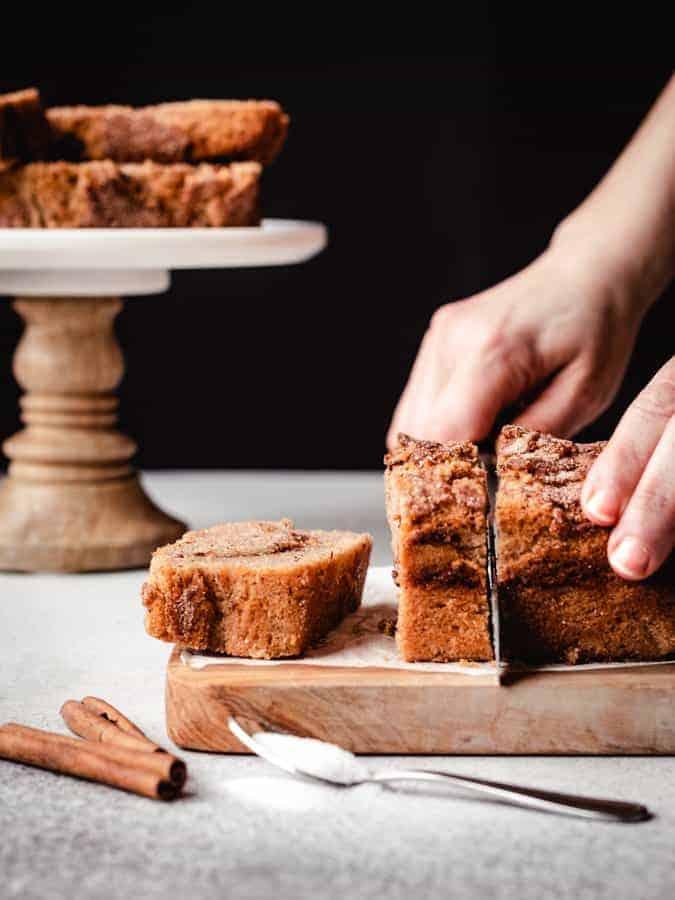 slicing through a cinnamon swirl loaf