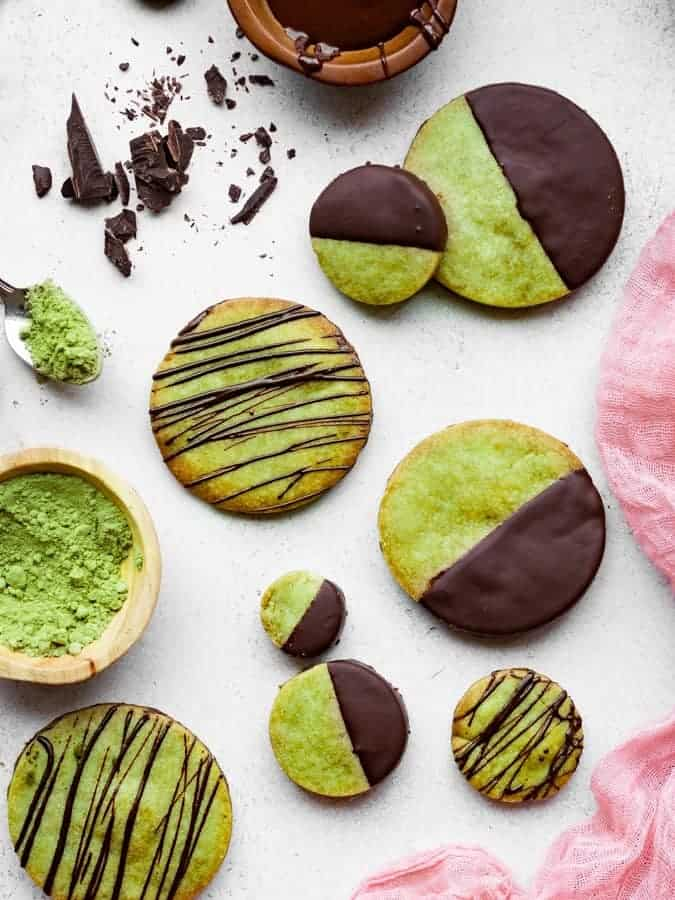 overhead of green tea shortbread cookies dipped in chocolate