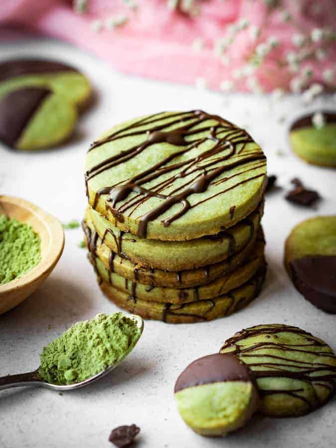 stack of green tea matcha cookies drizzled in dark chocolate