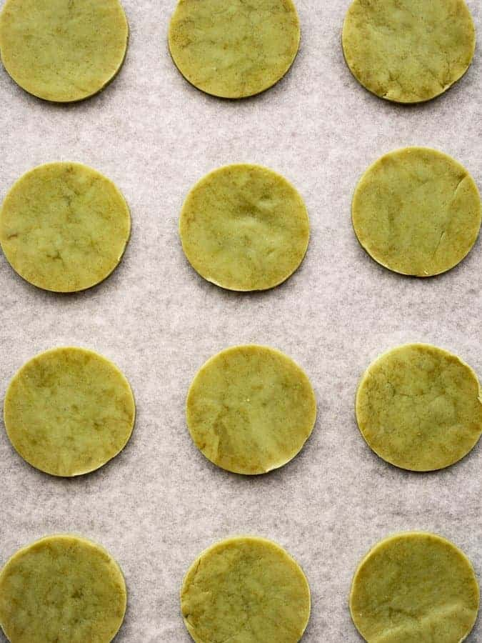 overhead of matcha green tea cookies ready to be baked on a tray