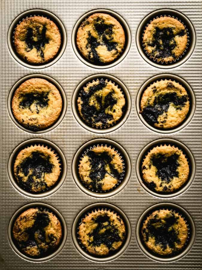 paleo lemon coconut flour muffins in a muffin tin
