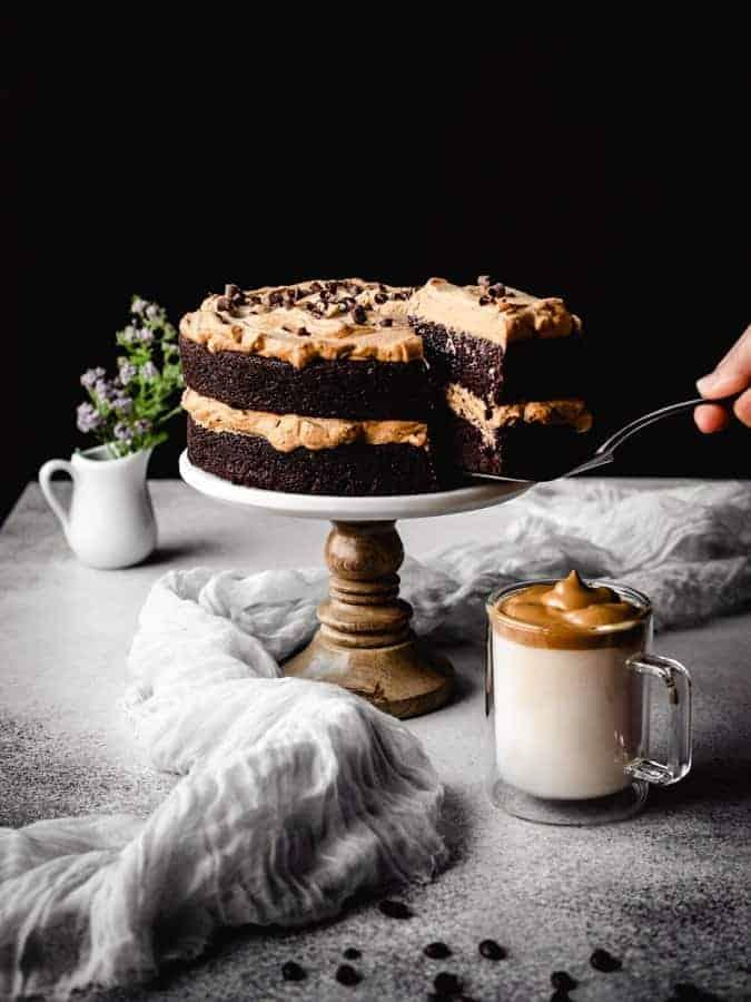 serving a slice of dalgona coffee chocolate cake