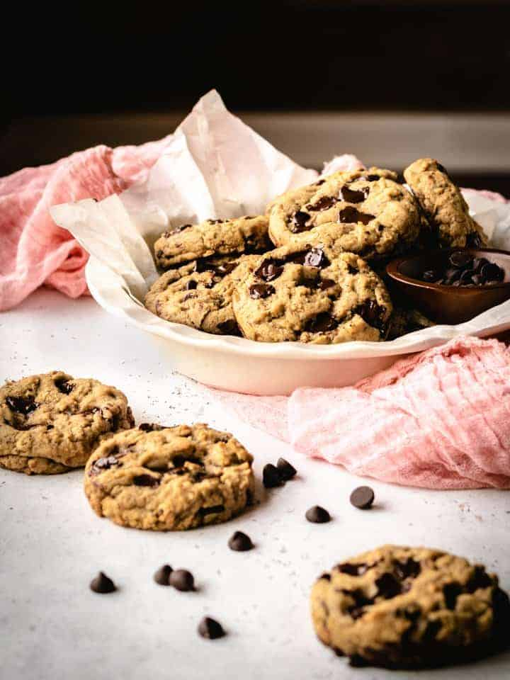 plant based cookies in a white dish with a pink cloth underneath