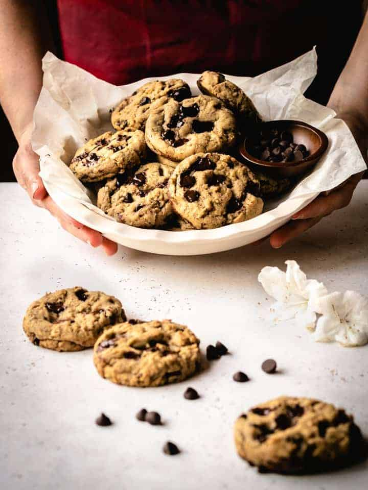 serving a dish of freshly baked cookies