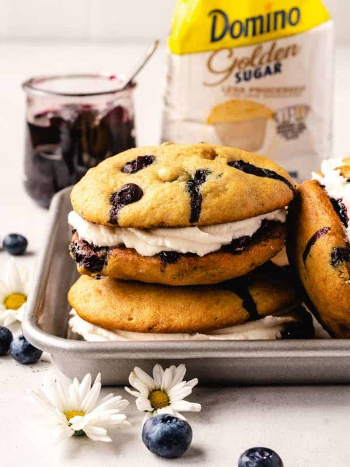 stack of blueberry whoopee pies with domino sugar behind
