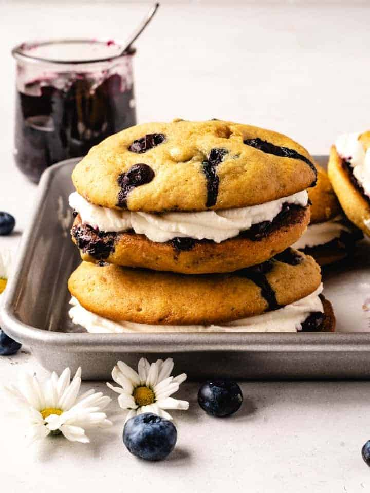 blueberry whoopee pies stacked with jam behind