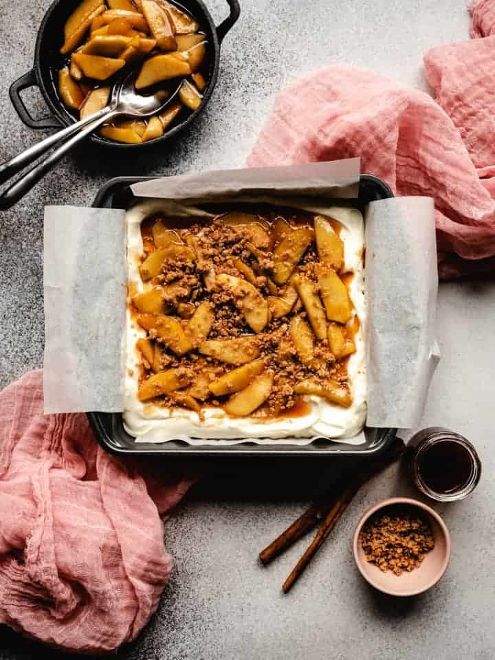 caramel apple cheesecake bars in a pan