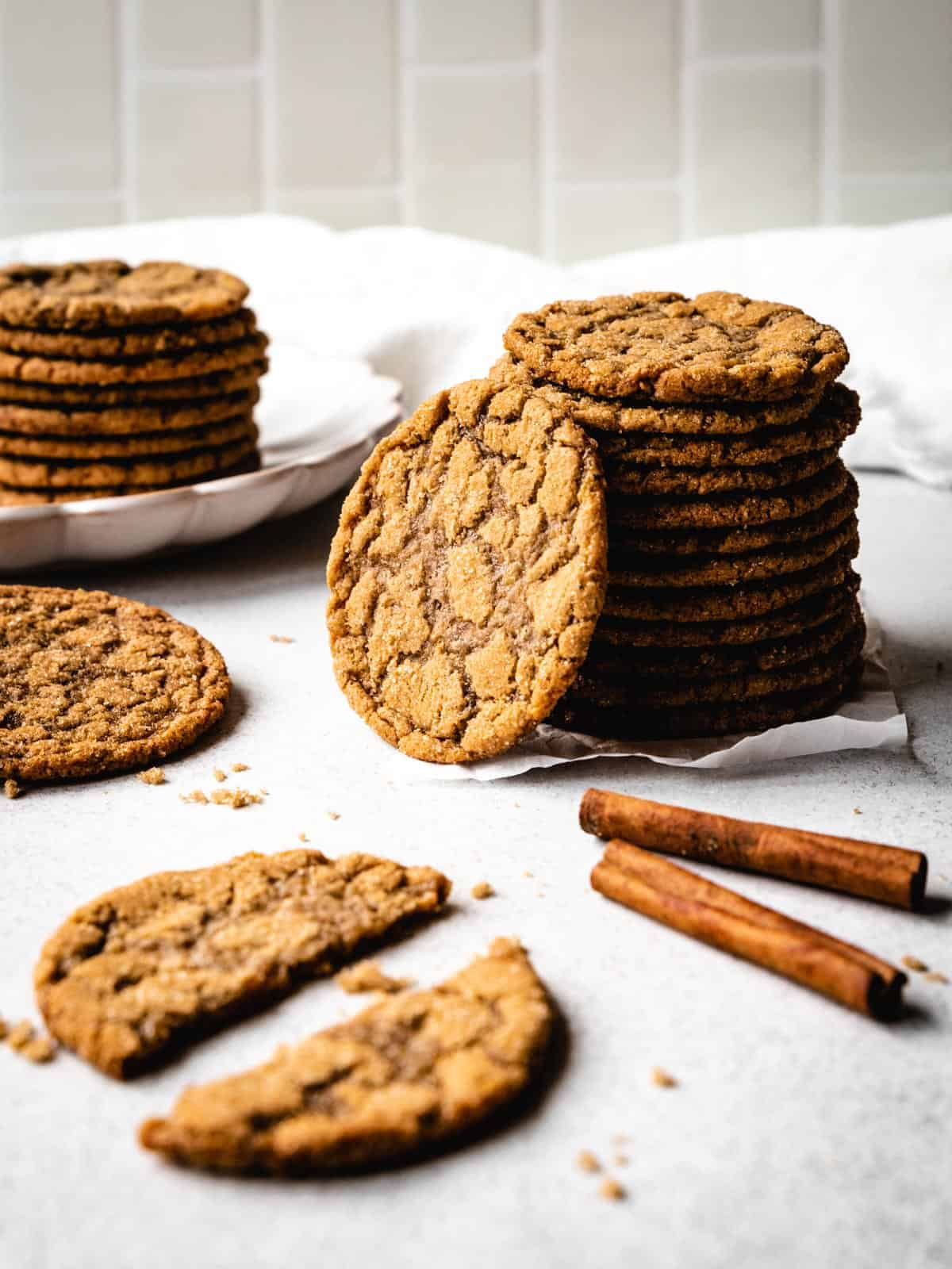 stack of brown sugar cookies with one leaning on the stack
