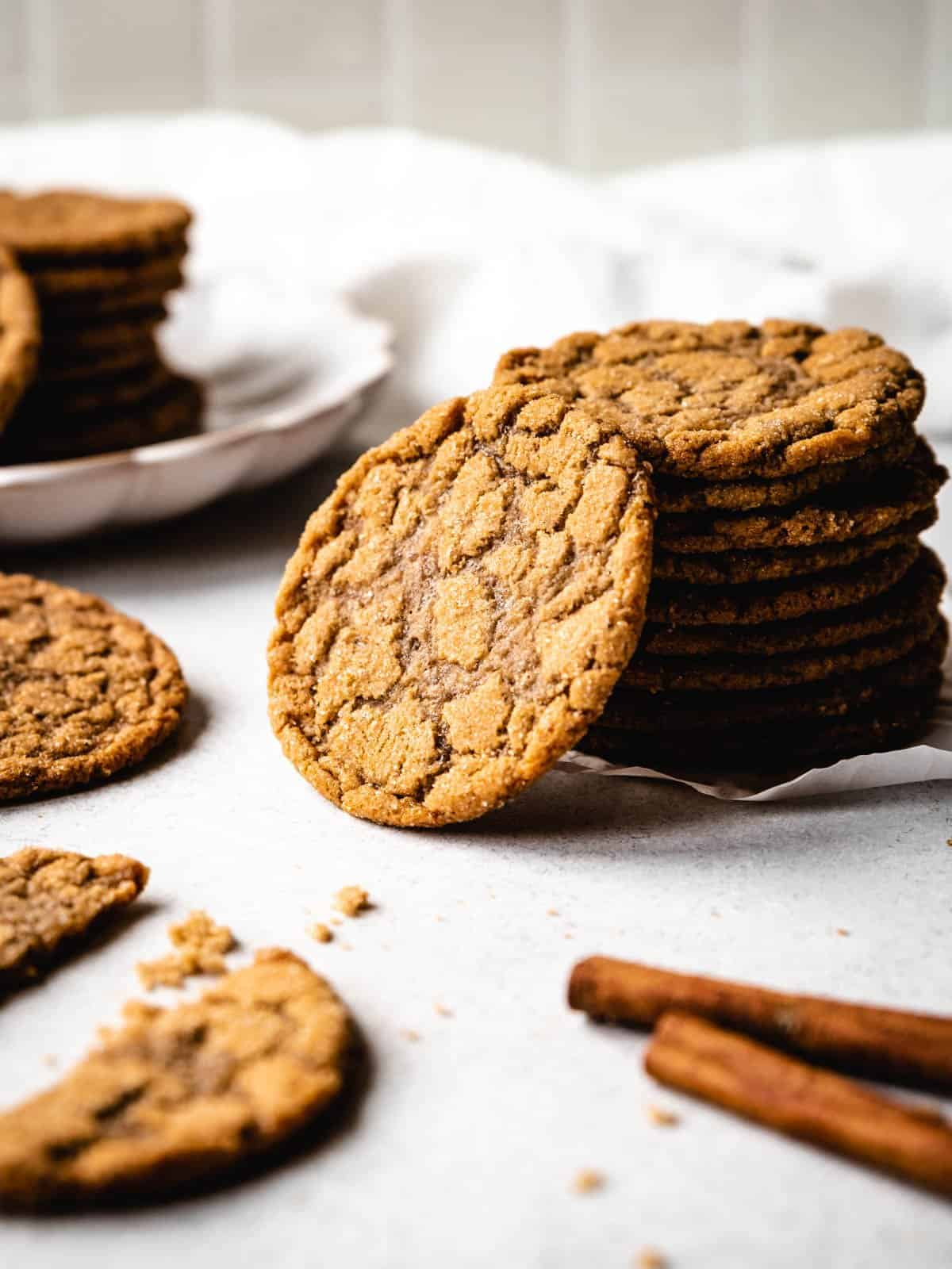 stack of brown sugar cookies with a cookie leaning against the stack