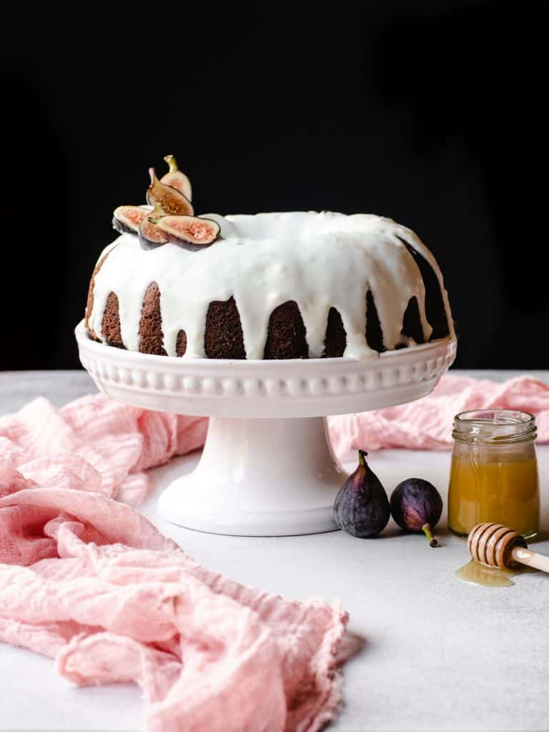 honey cake with goat cheese frosting with figs on it