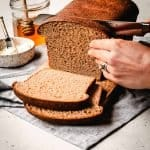 slicing honey whole wheat sandwich bread