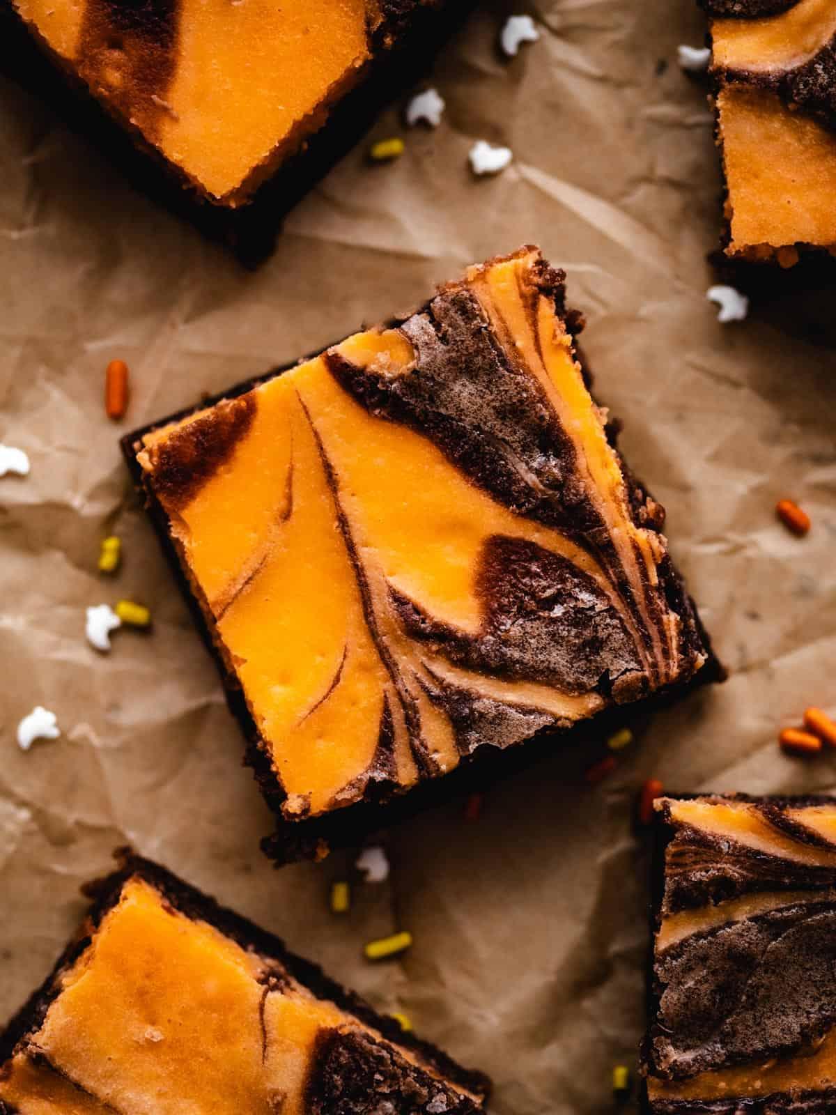 close up of orange and black cream cheese swirled brownie for Halloween