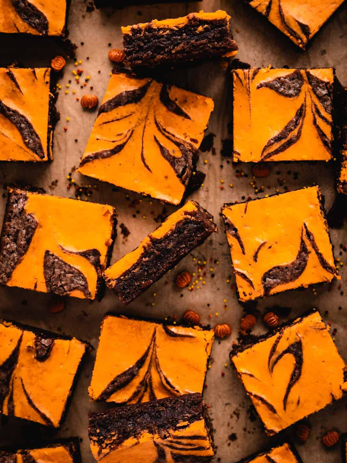 cream cheese brownies cut into squares showing the chewy texture