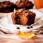 pumpkin muffin on a plate with a bite taken out