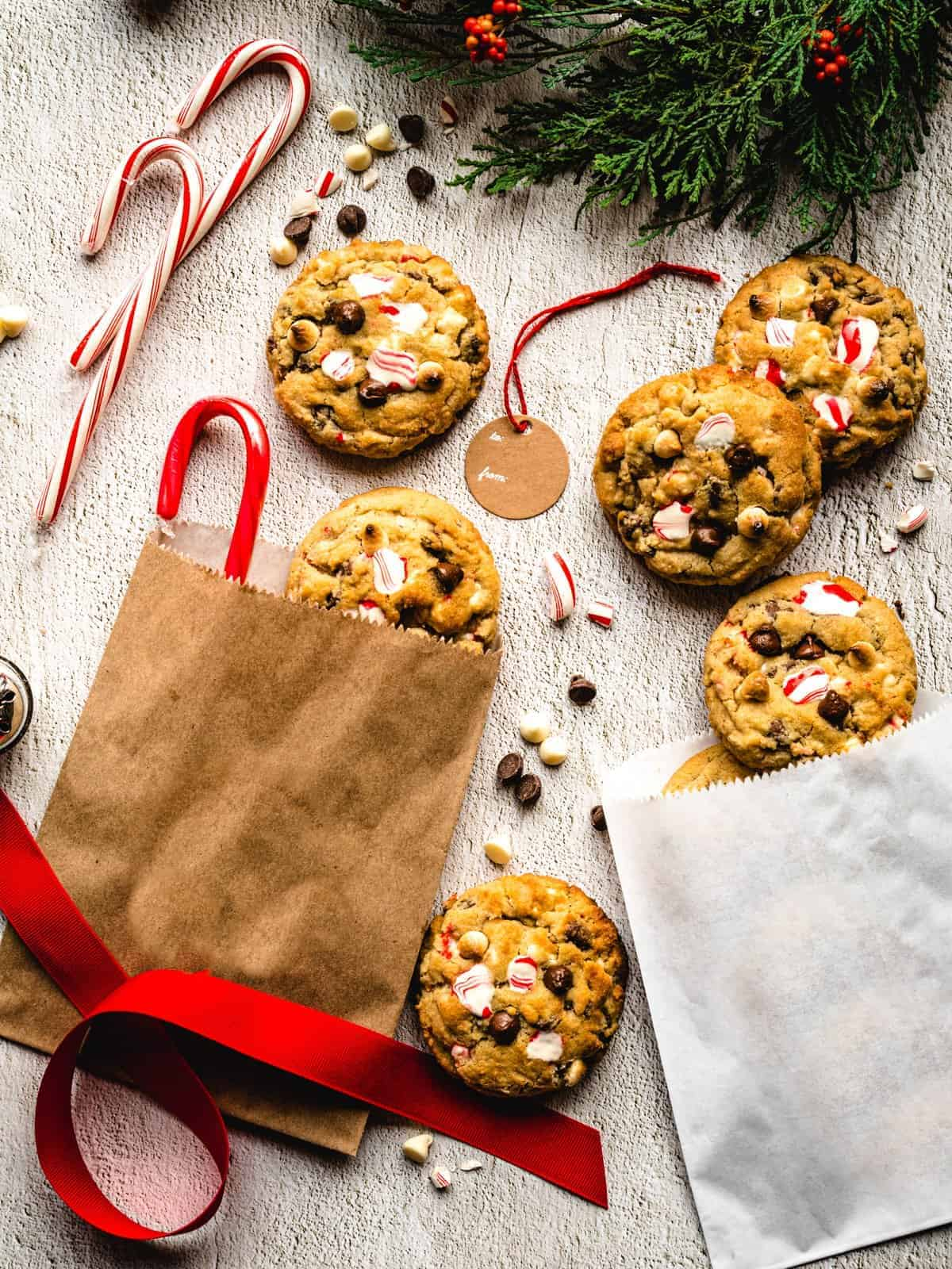 holiday decorations surrounding white chocolate peppermint chocolate chip cookies