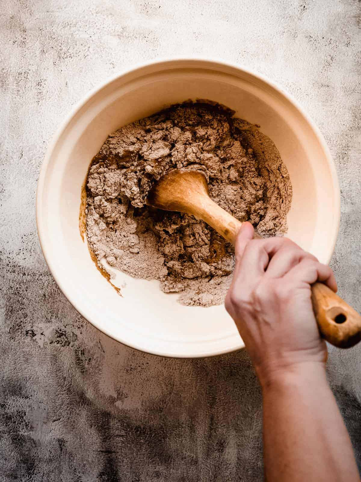 mixing muffin batter with a wooden spoon