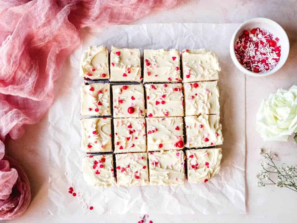 red velvet blondies with rose off to the side