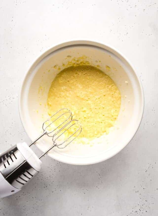 mixing sugar and butter to make loaf cake