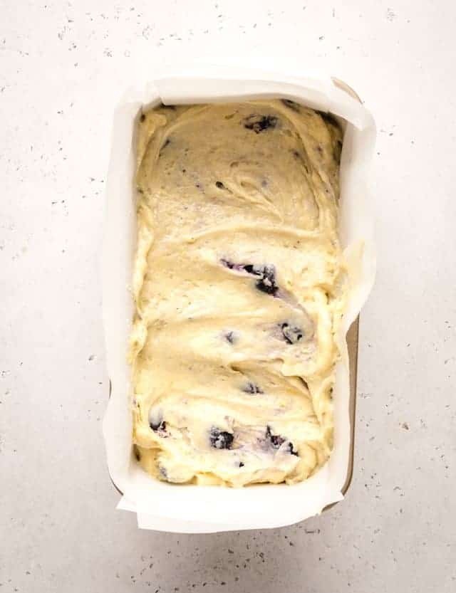 lemon blueberry loaf batter in a pan ready to be baked