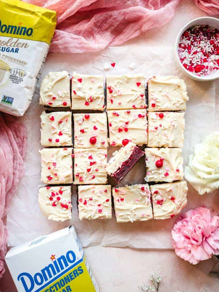 blondies with cream cheese frosting cut into squares