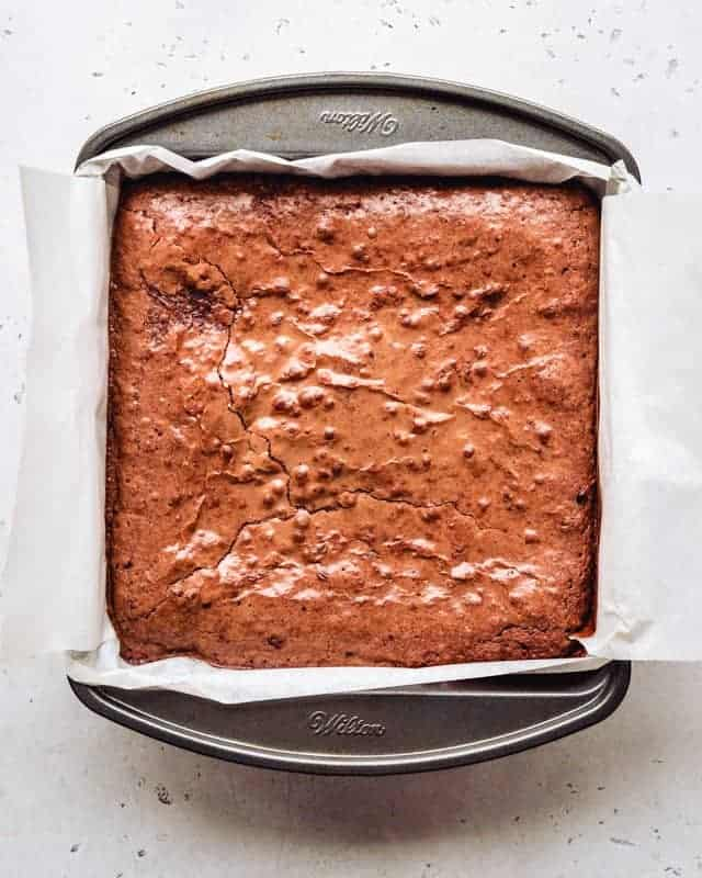 freshly baked chewy brownies in a square pan