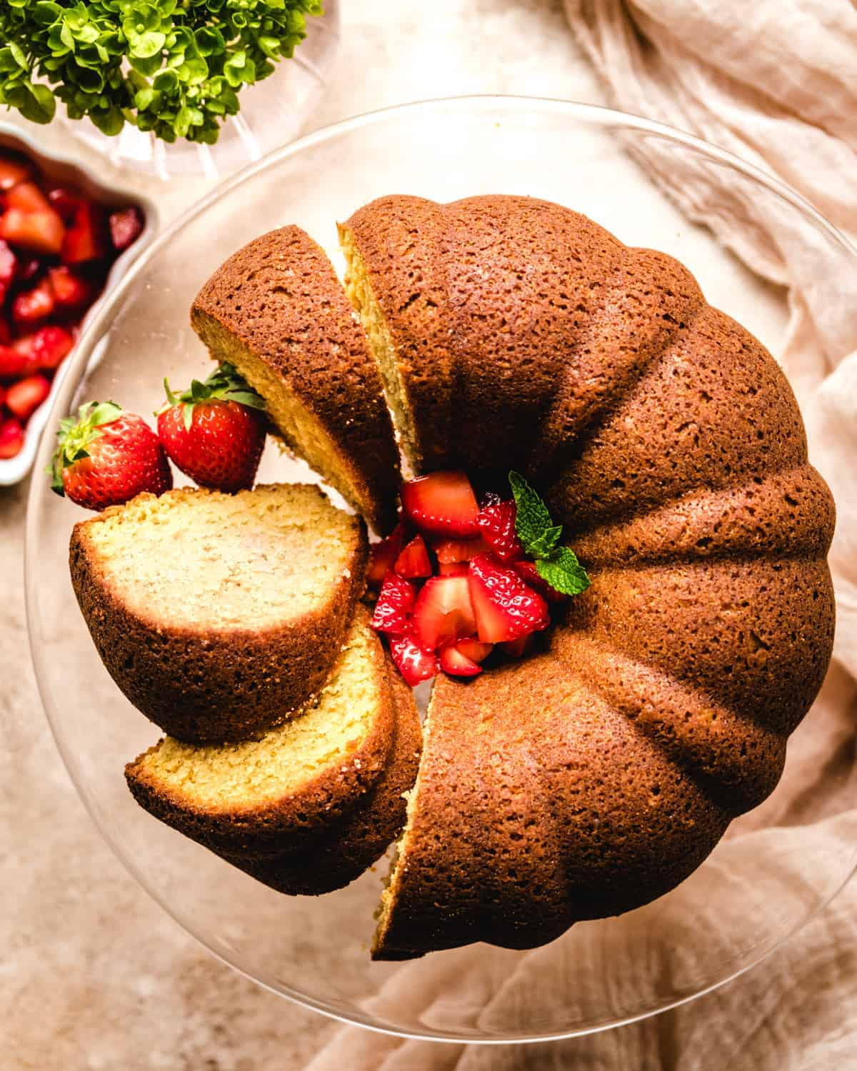 sliced brown sugar bundt cake on a glass cake stand