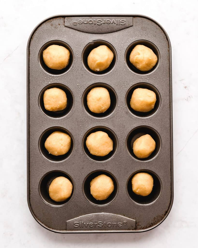 sugar cookie dough in a mini muffin tin ready to be baked