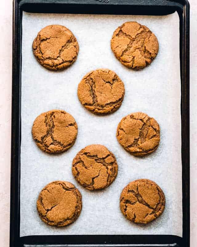overhead of malt ball cookies on a cookie sheet