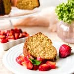 slice of brown sugar bundt cake on a plate with strawberries