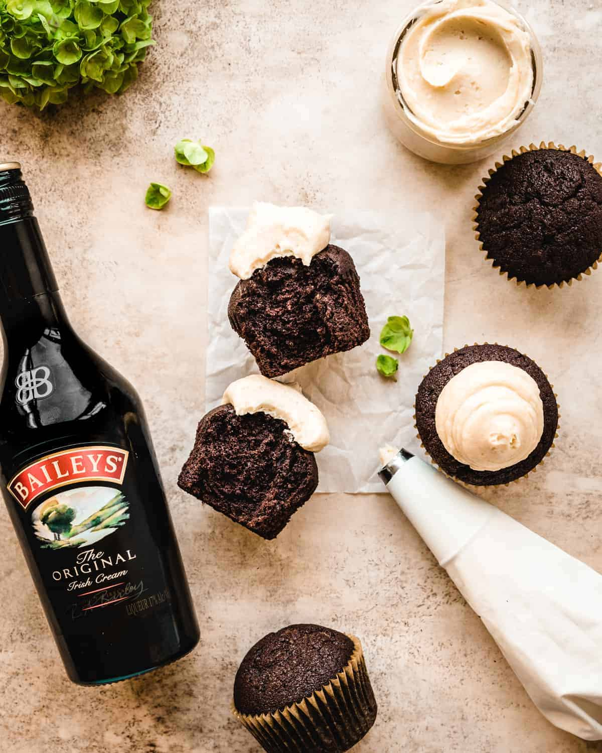 chocolate cupcakes with baileys buttercream and a bottle of baileys next to them