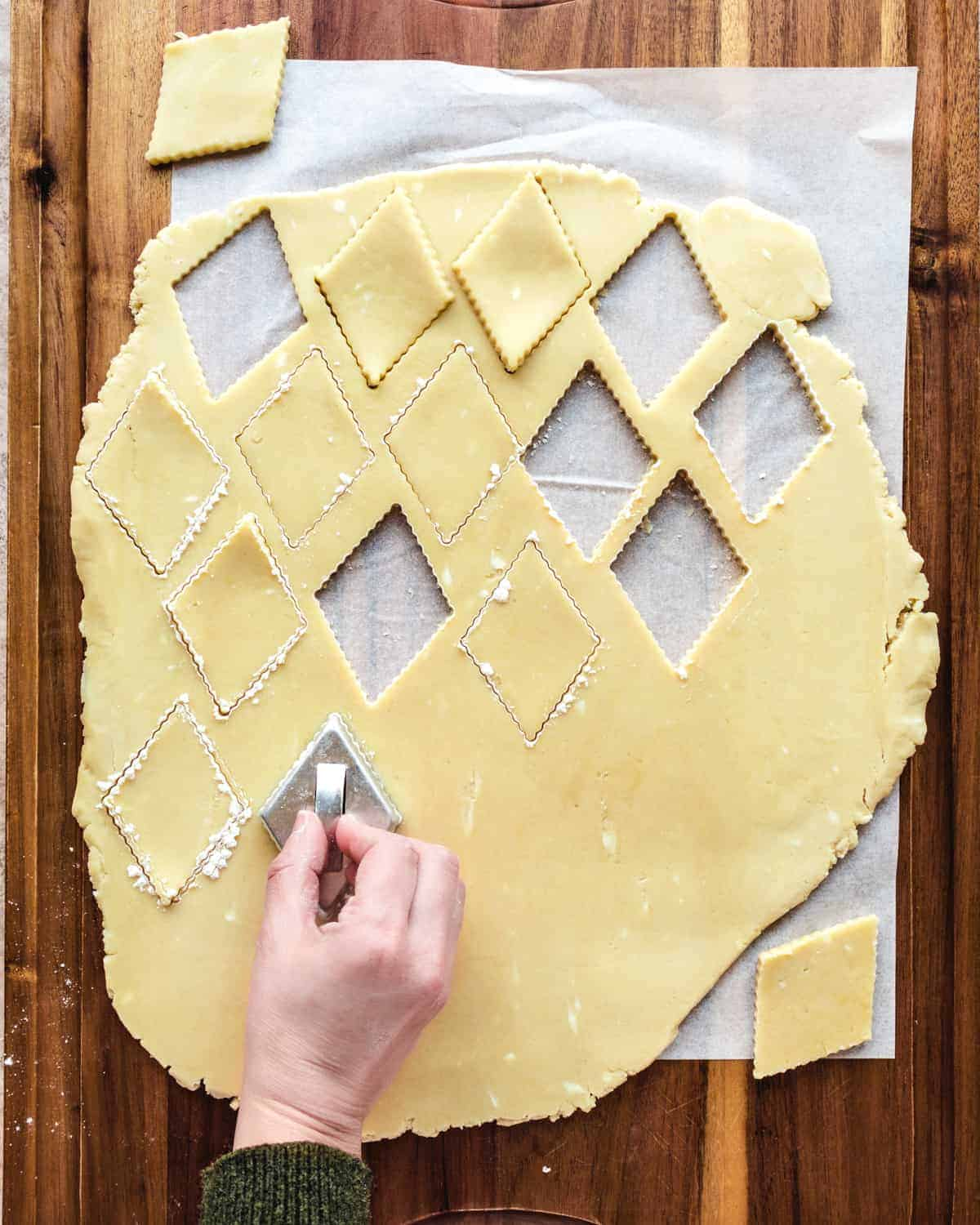 cutting out shapes from greek butter cookie dough